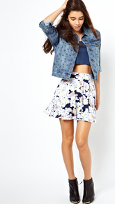 Skater Skirt In Floral Print - length: mid thigh; style: full/prom skirt; fit: loose/voluminous; waist detail: elasticated waist; waist: high rise; secondary colour: white; predominant colour: navy; occasions: casual, evening, holiday; fibres: viscose/rayon - stretch; hip detail: soft pleats at hip/draping at hip/flared at hip; trends: high impact florals; pattern type: knitted - big stitch; pattern size: big &amp; busy; pattern: florals; texture group: jersey - stretchy/drapey