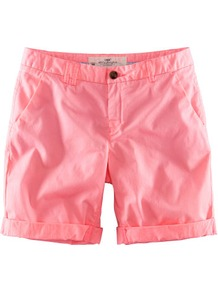 Shorts - pattern: plain; style: shorts; pocket detail: traditional 5 pocket; length: short shorts; waist: mid/regular rise; predominant colour: coral; occasions: casual, holiday; fibres: cotton - stretch; jeans & bottoms detail: turn ups; texture group: cotton feel fabrics; fit: slim leg; pattern type: fabric