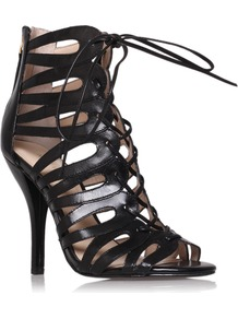 Kenie - predominant colour: black; occasions: evening, occasion, holiday; material: leather; heel height: high; embellishment: zips; ankle detail: ankle tie; heel: stiletto; toe: open toe/peeptoe; style: strappy; finish: plain; pattern: plain