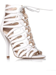 Kenie - predominant colour: white; occasions: evening, occasion, holiday; material: leather; heel height: high; embellishment: zips; ankle detail: ankle tie; heel: stiletto; toe: open toe/peeptoe; style: strappy; finish: plain; pattern: plain