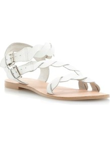 White Leather Jumpy Twist Strap Flat Sandal - predominant colour: white; occasions: casual, holiday; material: leather; heel height: flat; embellishment: buckles; ankle detail: ankle strap; heel: standard; toe: open toe/peeptoe; style: strappy; finish: plain; pattern: plain