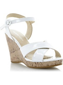 Gianna Patent Cross Strap Wedge Sandal - predominant colour: white; occasions: casual, holiday; material: leather; heel height: high; ankle detail: ankle strap; heel: wedge; toe: open toe/peeptoe; style: standard; finish: patent; pattern: plain