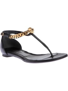 Opis Leather Thong Sandals - secondary colour: gold; predominant colour: black; occasions: casual, evening, holiday; material: leather; heel height: flat; ankle detail: ankle strap; heel: standard; toe: open toe/peeptoe; style: flip flops / toe post; finish: plain; pattern: plain; embellishment: chain/metal