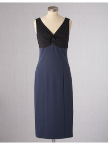 Paternoster Dress - style: shift; length: below the knee; neckline: low v-neck; fit: empire; pattern: plain; sleeve style: sleeveless; bust detail: knot twist front detail at bust; predominant colour: navy; occasions: casual, evening, work, occasion; fibres: cotton - mix; sleeve length: sleeveless; trends: glamorous day shifts; pattern type: fabric; pattern size: standard; texture group: jersey - stretchy/drapey