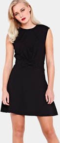 Aruna Jersey Bow Dress Black, Black - style: shift; length: mid thigh; neckline: round neck; fit: fitted at waist; pattern: plain; sleeve style: sleeveless; waist detail: twist front waist detail/nipped in at waist on one side/soft pleats/draping/ruching/gathering waist detail; bust detail: ruching/gathering/draping/layers/pintuck pleats at bust; predominant colour: black; occasions: evening, work, occasion; fibres: polyester/polyamide - mix; hip detail: sculpting darts/pleats/seams at hip; back detail: embellishment at back; sleeve length: sleeveless; trends: glamorous day shifts; pattern type: fabric; texture group: jersey - stretchy/drapey