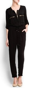 Long Jumpsuit Zippers - length: standard; neckline: round neck; fit: fitted at waist; pattern: plain; hip detail: side pockets at hip; bust detail: pocket detail at bust; waist detail: belted waist/tie at waist/drawstring; predominant colour: black; occasions: casual, evening, holiday; fibres: viscose/rayon - 100%; jeans & bottoms detail: turn ups; sleeve length: 3/4 length; sleeve style: standard; style: jumpsuit; pattern type: fabric; texture group: jersey - stretchy/drapey
