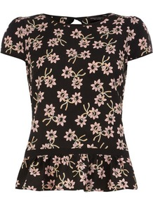 Black Daisy Print Frill Top - neckline: round neck; sleeve style: capped; waist detail: peplum waist detail; predominant colour: black; occasions: casual, evening, work; length: standard; style: top; fibres: polyester/polyamide - 100%; fit: straight cut; sleeve length: short sleeve; texture group: crepes; trends: high impact florals; hip detail: ruffles/tiers/tie detail at hip; pattern type: fabric; pattern size: big &amp; busy; pattern: florals