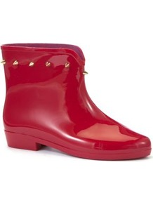 Red Spike Stud Ankle Wellies - predominant colour: true red; secondary colour: gold; occasions: casual, work; material: plastic/rubber; heel height: flat; embellishment: studs; heel: block; toe: round toe; boot length: ankle boot; style: wellies; finish: patent; pattern: plain