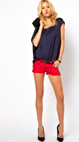 Red Denim Short - pattern: plain; style: shorts; waist: low rise; waist detail: belted waist/tie at waist/drawstring; pocket detail: traditional 5 pocket; length: short shorts; predominant colour: true red; occasions: casual, evening, holiday; fibres: cotton - stretch; jeans & bottoms detail: turn ups; fit: slim leg; pattern type: fabric; pattern size: standard; texture group: other - light to midweight