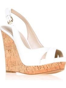 Laffnplay3 - predominant colour: white; occasions: casual, evening, holiday; material: leather; heel height: high; heel: wedge; toe: open toe/peeptoe; style: standard; finish: patent; pattern: plain