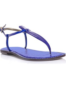 Gigi Sandals - predominant colour: royal blue; occasions: casual; material: leather; heel height: flat; ankle detail: ankle strap; heel: standard; toe: toe thongs; style: flip flops / toe post; finish: plain; pattern: plain