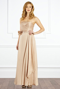 Allure Maxi Dress - style: ballgown; neckline: strapless (straight/sweetheart); pattern: plain; sleeve style: strapless; back detail: low cut/open back; waist detail: twist front waist detail/nipped in at waist on one side/soft pleats/draping/ruching/gathering waist detail; bust detail: ruching/gathering/draping/layers/pintuck pleats at bust; predominant colour: nude; occasions: evening, occasion; length: floor length; fit: fitted at waist & bust; fibres: silk - 100%; hip detail: soft pleats at hip/draping at hip/flared at hip; sleeve length: sleeveless; texture group: structured shiny - satin/tafetta/silk etc.; pattern type: fabric; embellishment: corsage