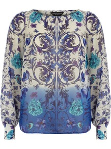 Blue Floral Ombre Print Top - neckline: round neck; sleeve style: extended cuff; predominant colour: lilac; secondary colour: pale blue; occasions: casual, evening, work, holiday; length: standard; style: top; fibres: polyester/polyamide - 100%; fit: straight cut; back detail: longer hem at back than at front; sleeve length: long sleeve; texture group: sheer fabrics/chiffon/organza etc.; trends: modern geometrics; pattern type: fabric; pattern size: big & busy; pattern: patterned/print