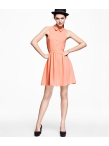 Dress - style: shirt; length: mid thigh; neckline: shirt collar/peter pan/zip with opening; pattern: plain; sleeve style: sleeveless; waist detail: fitted waist; bust detail: buttons at bust (in middle at breastbone)/zip detail at bust; predominant colour: coral; occasions: casual, evening, work; fit: fitted at waist & bust; fibres: polyester/polyamide - stretch; hip detail: soft pleats at hip/draping at hip/flared at hip; sleeve length: sleeveless; texture group: crepes; trends: glamorous day shifts, fluorescent; pattern type: fabric; pattern size: standard
