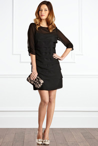 Claudina Dress - style: shift; neckline: round neck; fit: tailored/fitted; pattern: plain; shoulder detail: contrast pattern/fabric at shoulder; predominant colour: black; occasions: evening, occasion; length: just above the knee; fibres: polyester/polyamide - 100%; sleeve length: 3/4 length; sleeve style: standard; texture group: sheer fabrics/chiffon/organza etc.; bust detail: tiers/frills/bulky drapes/pleats; hip detail: ruffles/tiers/tie detail at hip; pattern type: fabric; pattern size: standard