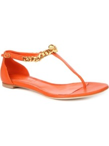 Opis Leather Thong Sandals - predominant colour: bright orange; occasions: casual, evening, holiday; material: leather; heel height: flat; ankle detail: ankle strap; heel: standard; toe: toe thongs; style: flip flops / toe post; trends: fluorescent; finish: plain; pattern: plain; embellishment: chain/metal