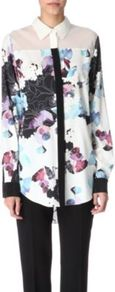 Silk Floral Shirt - neckline: shirt collar/peter pan/zip with opening; bust detail: sheer at bust, added detail/embellishment at bust, buttons at bust (in middle at breastbone)/zip detail at bust, contrast pattern/fabric/detail at bust; length: below the bottom; style: shirt; shoulder detail: contrast pattern/fabric at shoulder; predominant colour: white; occasions: casual, evening, work; fibres: silk - mix; fit: straight cut; hip detail: dip hem; back detail: sheer fabric at back, longer hem at back than at front; sleeve length: long sleeve; sleeve style: standard; texture group: crepes; trends: high impact florals; pattern type: fabric; pattern size: big &amp; busy; pattern: florals