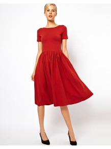 Midi Dress With Short Sleeves - length: below the knee; neckline: round neck; pattern: plain; waist detail: twist front waist detail/nipped in at waist on one side/soft pleats/draping/ruching/gathering waist detail; predominant colour: bright orange; occasions: evening, work; fit: fitted at waist &amp; bust; style: fit &amp; flare; fibres: cotton - stretch; hip detail: soft pleats at hip/draping at hip/flared at hip; sleeve length: short sleeve; sleeve style: standard; trends: volume; pattern type: fabric; texture group: jersey - stretchy/drapey
