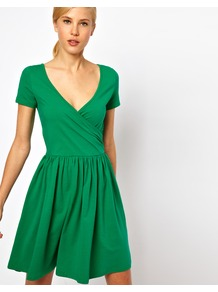 Skater Dress With Ballet Wrap And Short Sleeves. - style: faux wrap/wrap; neckline: low v-neck; pattern: plain; waist detail: twist front waist detail/nipped in at waist on one side/soft pleats/draping/ruching/gathering waist detail; predominant colour: emerald green; occasions: casual, evening; length: just above the knee; fit: fitted at waist & bust; fibres: cotton - stretch; hip detail: soft pleats at hip/draping at hip/flared at hip; sleeve length: short sleeve; sleeve style: standard; trends: volume; pattern type: fabric; texture group: jersey - stretchy/drapey