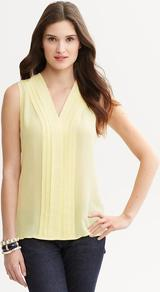 Yellow Silk Pleat Front Blouse - neckline: v-neck; sleeve style: sleeveless; style: blouse; bust detail: ruching/gathering/draping/layers/pintuck pleats at bust; predominant colour: primrose yellow; occasions: casual, evening, work; length: standard; fibres: silk - 100%; fit: straight cut; sleeve length: sleeveless; texture group: silky - light; pattern type: fabric; pattern size: standard