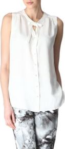 Button Front Shirt - pattern: plain; sleeve style: sleeveless; style: blouse; predominant colour: white; occasions: casual, work; length: standard; neckline: peep hole neckline; fit: body skimming; sleeve length: sleeveless; fibres: viscose/rayon - mix