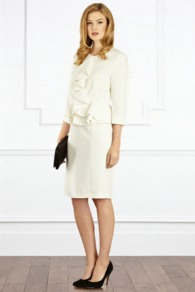 Letizia Ruffle Jacket - pattern: plain; style: single breasted blazer; bust detail: added detail/embellishment at bust; collar: round collar/collarless; predominant colour: ivory; occasions: evening, occasion; length: standard; fit: tailored/fitted; fibres: polyester/polyamide - mix; waist detail: peplum detail at waist; sleeve length: 3/4 length; sleeve style: standard; texture group: structured shiny - satin/tafetta/silk etc.; collar break: high; pattern type: fabric