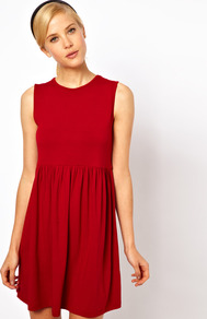 Sleeveless Smock Dress - style: smock; length: mid thigh; fit: empire; pattern: plain; sleeve style: sleeveless; waist detail: twist front waist detail/nipped in at waist on one side/soft pleats/draping/ruching/gathering waist detail; predominant colour: true red; occasions: casual, evening; fibres: viscose/rayon - stretch; neckline: crew; hip detail: soft pleats at hip/draping at hip/flared at hip; sleeve length: sleeveless; pattern type: fabric; texture group: jersey - stretchy/drapey
