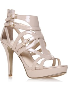 Bronnie3 - predominant colour: stone; occasions: evening, occasion; material: faux leather; embellishment: buckles; ankle detail: ankle strap; heel: platform; toe: open toe/peeptoe; style: strappy; finish: patent; pattern: plain; heel height: very high