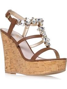 Marcie - predominant colour: chocolate brown; occasions: casual, evening, holiday; material: faux leather; embellishment: crystals; ankle detail: ankle strap; heel: platform; toe: open toe/peeptoe; style: strappy; finish: plain; pattern: plain; heel height: very high
