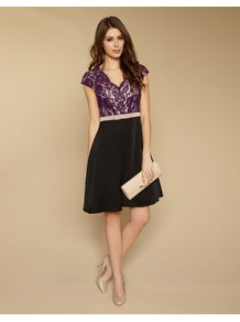 Olivia Lace Prom - style: shift; neckline: low v-neck; sleeve style: capped; fit: fitted at waist; waist detail: embellishment at waist/feature waistband; secondary colour: purple; predominant colour: black; occasions: evening, occasion; length: just above the knee; fibres: polyester/polyamide - mix; bust detail: contrast pattern/fabric/detail at bust; sleeve length: short sleeve; texture group: lace; pattern type: fabric; pattern size: standard; pattern: colourblock; embellishment: lace