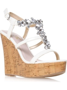 Marcie - predominant colour: white; occasions: evening, occasion, holiday; material: faux leather; heel height: high; embellishment: crystals; ankle detail: ankle strap; heel: wedge; toe: open toe/peeptoe; style: strappy; finish: plain; pattern: plain