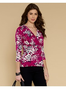 Francine Print Top - neckline: low v-neck; style: wrap/faux wrap; waist detail: twist front waist detail/nipped in at waist on one side/soft pleats/draping/ruching/gathering waist detail; secondary colour: ivory; predominant colour: hot pink; occasions: casual, evening, work; length: standard; fibres: viscose/rayon - stretch; fit: body skimming; sleeve length: 3/4 length; sleeve style: standard; trends: high impact florals; pattern type: fabric; pattern size: small &amp; busy; pattern: florals; texture group: jersey - stretchy/drapey
