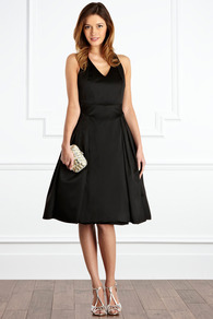 Xanthe Duchess Satin Dress - neckline: low v-neck; pattern: plain; sleeve style: sleeveless; style: full skirt; predominant colour: black; occasions: evening, occasion; length: on the knee; fit: fitted at waist & bust; fibres: polyester/polyamide - stretch; hip detail: sculpting darts/pleats/seams at hip; back detail: crossover; sleeve length: sleeveless; texture group: structured shiny - satin/tafetta/silk etc.; trends: volume; pattern type: fabric