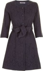 Dark Grey Mylie Lace Mac A - bust detail: added detail/embellishment at bust; hip detail: side pockets at hip; collar: round collar/collarless; style: mac; predominant colour: black; occasions: evening, occasion; fit: tailored/fitted; fibres: cotton - stretch; length: below the knee; waist detail: belted waist/tie at waist/drawstring; sleeve length: 3/4 length; sleeve style: standard; texture group: lace; collar break: high; pattern type: fabric; pattern size: small & busy; pattern: patterned/print; embellishment: lace
