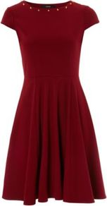 Studded Ponte Fit And Flare Dress Burgundy - neckline: round neck; sleeve style: capped; pattern: plain; bust detail: added detail/embellishment at bust; waist detail: fitted waist; predominant colour: burgundy; occasions: casual, evening, occasion; length: just above the knee; fit: fitted at waist & bust; style: fit & flare; fibres: polyester/polyamide - stretch; hip detail: structured pleats at hip; sleeve length: short sleeve; pattern type: fabric; pattern size: standard; texture group: jersey - stretchy/drapey; embellishment: studs