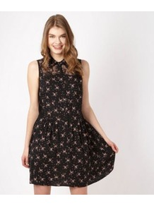 Designer Black Floral Lace Dress - style: shirt; length: mid thigh; neckline: shirt collar/peter pan/zip with opening; fit: fitted at waist; sleeve style: sleeveless; waist detail: fitted waist, twist front waist detail/nipped in at waist on one side/soft pleats/draping/ruching/gathering waist detail; shoulder detail: contrast pattern/fabric at shoulder; back detail: contrast pattern/fabric at back; bust detail: buttons at bust (in middle at breastbone)/zip detail at bust, contrast pattern/fabric/detail at bust; predominant colour: black; occasions: casual, evening, work, holiday; fibres: polyester/polyamide - 100%; hip detail: structured pleats at hip, soft pleats at hip/draping at hip/flared at hip; sleeve length: sleeveless; trends: high impact florals; pattern type: fabric; pattern size: small &amp; busy; pattern: florals, patterned/print; texture group: jersey - stretchy/drapey