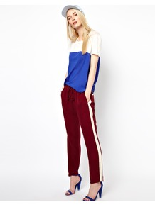 Sporty Trousers - length: standard; pattern: plain; style: tracksuit pants; waist detail: elasticated waist; pocket detail: small back pockets, pockets at the sides; waist: mid/regular rise; secondary colour: white; predominant colour: burgundy; occasions: casual, evening, holiday; fibres: polyester/polyamide - 100%; fit: straight leg; pattern type: fabric; pattern size: small & light; texture group: jersey - stretchy/drapey