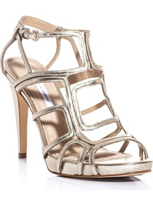 Jeanette Sandals - predominant colour: gold; occasions: evening, occasion, holiday; material: leather; heel height: high; embellishment: buckles; ankle detail: ankle strap; heel: stiletto; toe: open toe/peeptoe; style: strappy; trends: metallics; finish: metallic; pattern: plain
