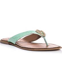 Kyra Sandals - predominant colour: pistachio; occasions: casual, holiday; material: leather; heel height: flat; heel: standard; toe: toe thongs; style: flip flops / toe post; finish: patent; pattern: plain; embellishment: chain/metal