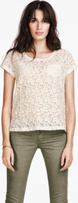 Top - neckline: round neck; pattern: plain, patterned/print; style: t-shirt; bust detail: pocket detail at bust; predominant colour: ivory; occasions: casual, evening, work; length: standard; fibres: cotton - mix; fit: straight cut; back detail: embellishment at back; sleeve length: short sleeve; sleeve style: standard; texture group: lace; pattern type: fabric; pattern size: standard
