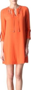 Kea Dress - style: smock; length: mid thigh; fit: loose; pattern: plain; bust detail: added detail/embellishment at bust; shoulder detail: contrast pattern/fabric at shoulder; predominant colour: bright orange; occasions: casual, evening, work, occasion, holiday; fibres: polyester/polyamide - 100%; neckline: crew; sleeve length: 3/4 length; sleeve style: standard; texture group: crepes; trends: glamorous day shifts, fluorescent; pattern type: fabric; pattern size: standard