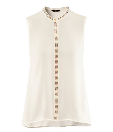 Blouse - sleeve style: sleeveless; neckline: high neck; style: blouse; predominant colour: ivory/cream; occasions: evening, work; length: standard; fibres: polyester/polyamide - 100%; fit: straight cut; back detail: longer hem at back than at front; sleeve length: sleeveless; texture group: sheer fabrics/chiffon/organza etc.; pattern type: fabric; pattern size: light/subtle; embellishment: beading; season: s/s 2013