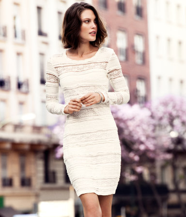 Dress - neckline: round neck; fit: tight; style: bodycon; waist detail: fitted waist; predominant colour: ivory/cream; occasions: casual, evening; length: just above the knee; fibres: cotton - mix; sleeve length: long sleeve; sleeve style: standard; texture group: lace; pattern type: fabric; pattern size: standard; pattern: patterned/print; season: s/s 2013