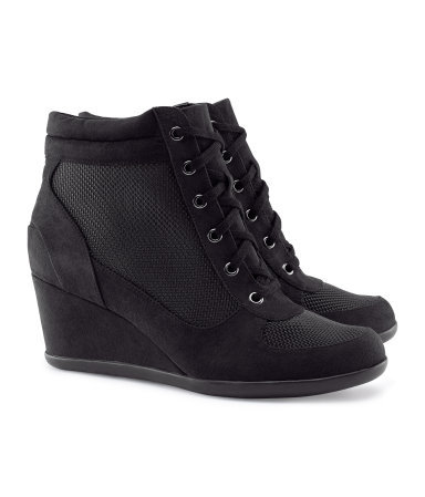 Sneakers - predominant colour: black; occasions: casual; material: fabric; heel height: mid; heel: wedge; toe: round toe; boot length: ankle boot; style: high top; trends: sporty redux; finish: plain; pattern: plain; season: s/s 2013