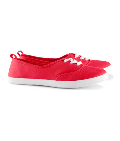 Sneakers - predominant colour: true red; occasions: casual, holiday; material: fabric; heel height: flat; toe: round toe; style: trainers; trends: sporty redux; finish: plain; pattern: plain; season: s/s 2013
