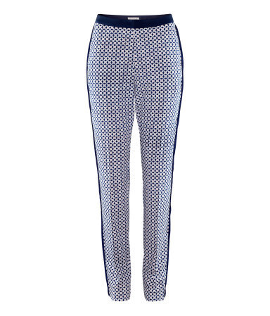Trousers - length: standard; pocket detail: small back pockets, pockets at the sides; waist: mid/regular rise; predominant colour: navy; occasions: casual, work; fibres: polyester/polyamide - stretch; waist detail: narrow waistband; trends: statement prints; fit: slim leg; pattern type: fabric; pattern: patterned/print; texture group: other - light to midweight; style: standard; season: s/s 2013; pattern size: standard (bottom)