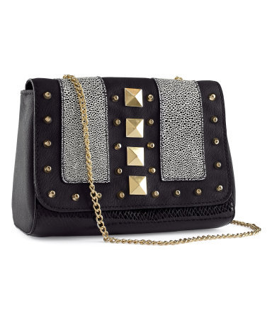 Shoulder Bag - predominant colour: black; occasions: casual, creative work; type of pattern: small; style: shoulder; length: shoulder (tucks under arm); size: small; material: faux leather; embellishment: studs; finish: plain; pattern: patterned/print; season: s/s 2013
