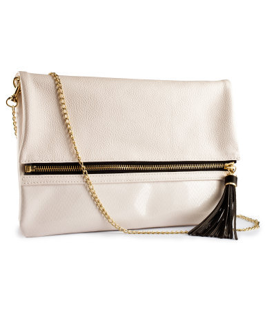 Clutch - predominant colour: ivory/cream; occasions: casual, evening, occasion; type of pattern: light; style: clutch; length: hand carry; size: standard; material: faux leather; pattern: plain; finish: plain; season: s/s 2013