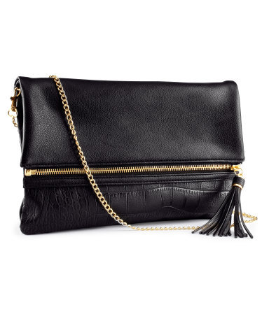 Clutch - predominant colour: black; occasions: casual, evening, occasion; type of pattern: light; style: clutch; length: hand carry; size: standard; material: faux leather; pattern: plain; finish: plain; season: s/s 2013