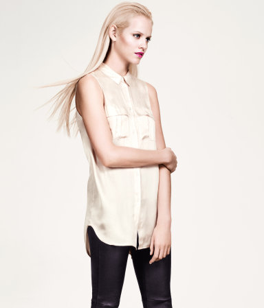 Blouse - neckline: shirt collar/peter pan/zip with opening; pattern: plain; sleeve style: sleeveless; length: below the bottom; bust detail: pocket detail at bust; style: blouse; predominant colour: ivory/cream; occasions: casual, evening, work; fibres: polyester/polyamide - 100%; fit: straight cut; back detail: longer hem at back than at front; sleeve length: sleeveless; texture group: structured shiny - satin/tafetta/silk etc.; pattern type: fabric; pattern size: standard; season: s/s 2013